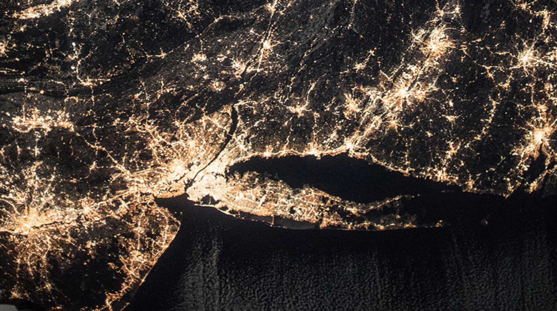 The well-lit coasts of New Jersey, New York and Connecticut are pictured in the wee hours of New Year's Day.