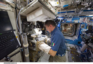 European Space Agency astronaut Paolo Nespoli operating the Light Microscopy Module microscope aboard the International Space Station on a previous mission. Credits: NASA